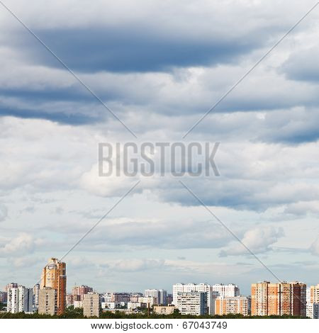 Overcast Grey Sky Over Town In Summer