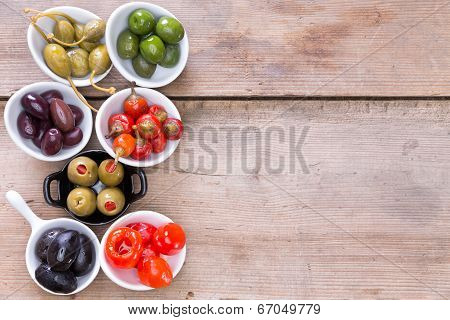 Assortment Of Cured Olives And Peppers