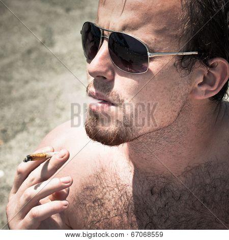 Man Smoking Hashish Joint