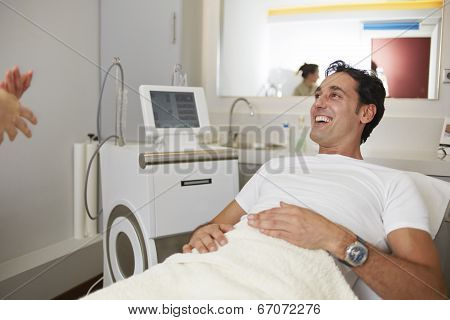 Adult patient smiling to doctor seated in the medical chair