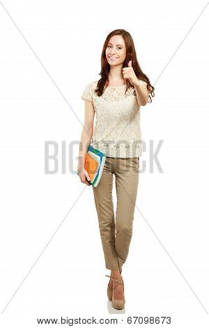 Woman with books showing thumb up