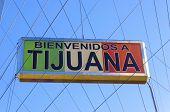 The Bienvenidos a Tijuana sign on the Millennial Arch (Arco y Reloj Monumental) a metallic steel arch at the entrance of the city in Mexico at zona centro a symbol to the new millennium and a landmark that welcomes tourists in Avenida de revolucion. poster