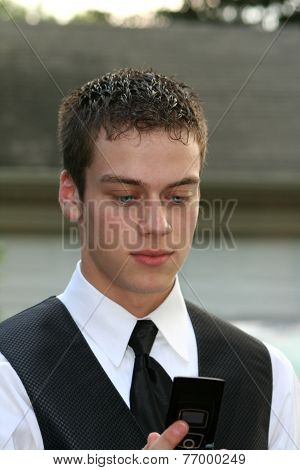 Prom Boy Looking At Cell Phone