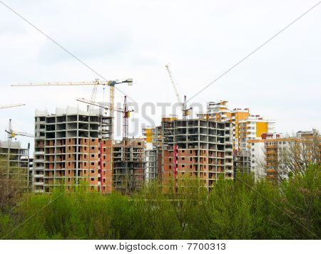 Construction Work Site Place Concept With Cranes And Buildings