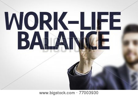 Business man pointing to transparent board with text: Work-Life Balance