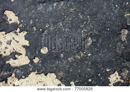 Concrete Surface Partly Covered With Black Tar