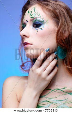 portrait of beautiful girl with bodyart of algae posing on blue poster
