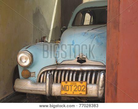 Old-fashioned Cuban Car In A Garage