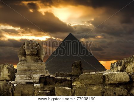 The Sphinx And The Pyramid Of Cheops In Giza Egipt  At Sunset