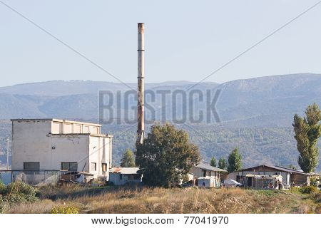 Shantytown Near An A Old Chimney