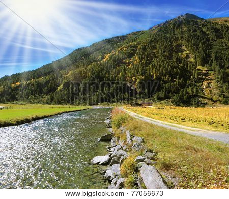 Austrian Alps. Headwaters of the famous Krimml waterfalls. Crystal clear water glows in the midday sun.