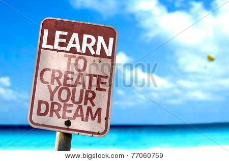Learn To Create Your Dream sign with a beach on background