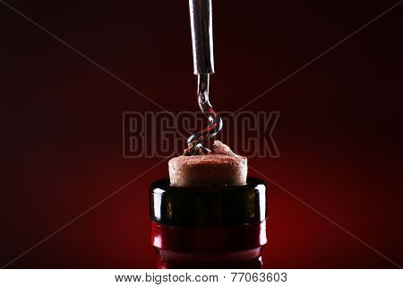 Bottle opener close-up, on dark color background