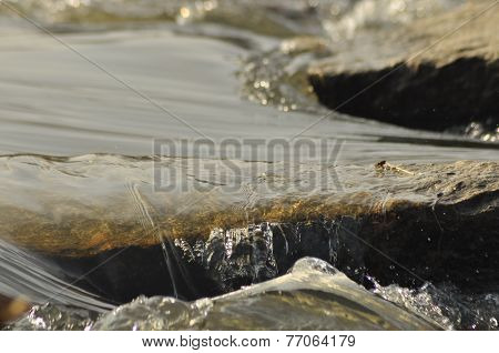 Stones In The River. Fast Flowing Water. Refreshing Mountain River Stream.