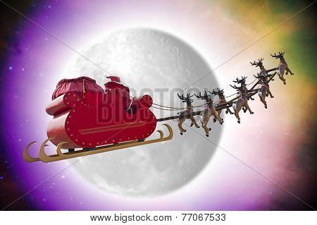 Santa Claus riding a sleigh in dusk led by reindeers passing in front of the moon