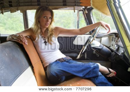 Blonde Model In An Abandoned Vehicle