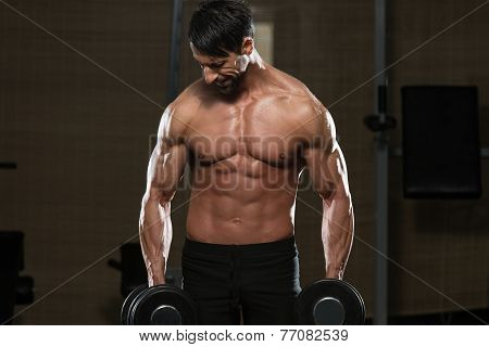Male Athlete Doing Heavy Weight Exercise For Trapezius
