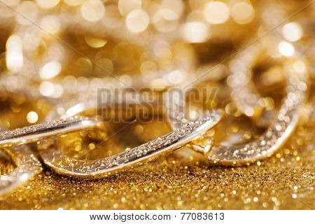 close up of golden chainlet. gold luxury jewelery. luxe glitter background