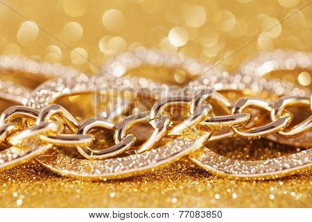 close up of gold chainlet. luxe golden glitter background
