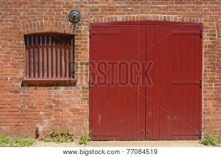 Red Door And Window In Brick Wall