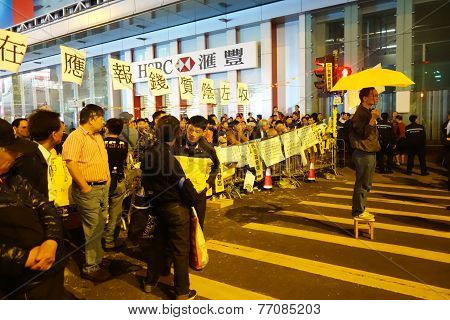 Protester Holds A Yellow Umbrella To Protest In Mong Kok, Hong Kong