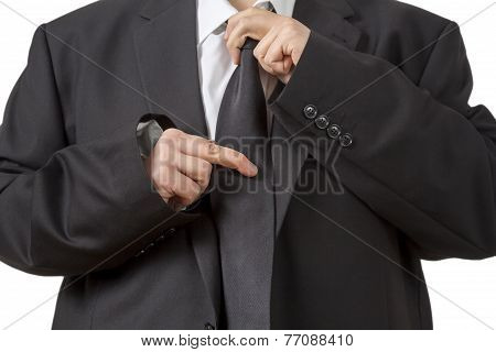 Man In Siut Straightening His Tie