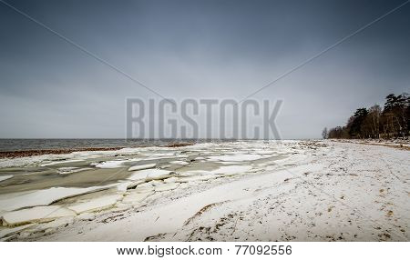 Baltic sea shore in ice and snow in the beginning of winter poster