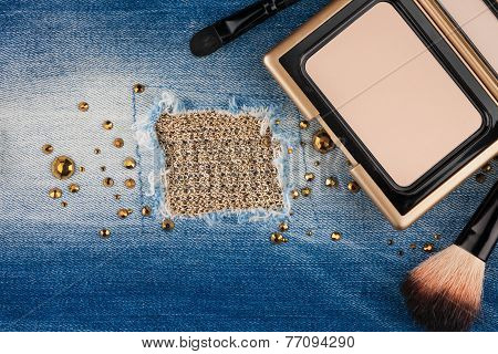 poster of Still life from cosmetics on ragged jeans with rhinestones with place for your text