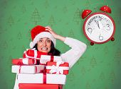 Shocked woman with christmas presents against green christmas tree pattern poster