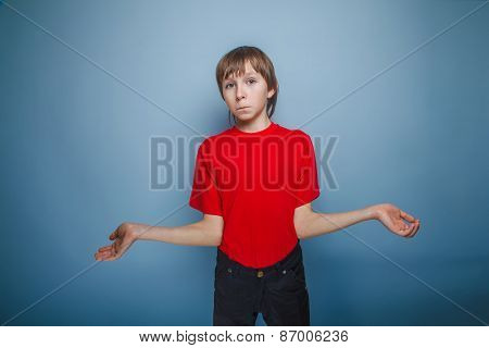 teenager boy brown European appearance in a red shirt opened his