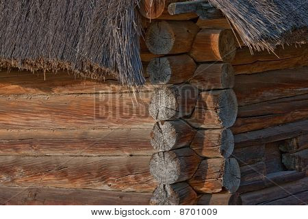 Part Of The Ukrainian Hut. Wooden Walls. Thatched Roof.