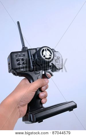 Hand holding hobby car remote control