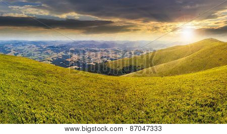 Wild Grass On Mountain Top At Sunset