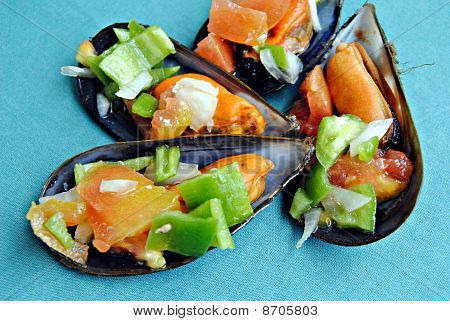 Chopping mussels vinaigrette on a green background poster