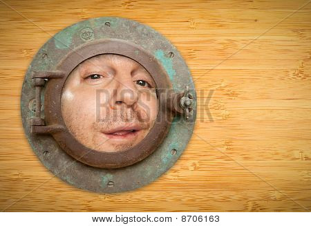 Antique Porthole On Bamboo Wall With Funky Man Looking Through