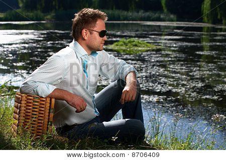 Traveling Man At The River Shore