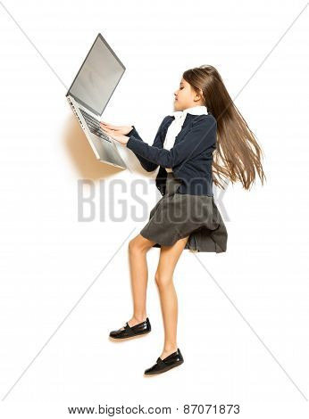 Photo From Top Of Cute Girl Lying On Floor And Using Laptop