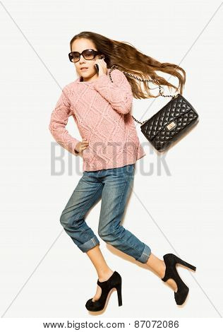 Isolated shot from top view of stylish girl lying on floor and pretending to walk poster
