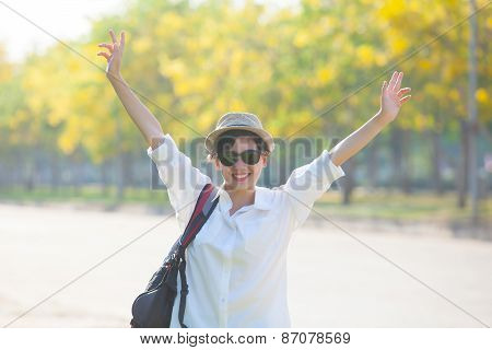 Young Beautiful Woman Wearing White Shirts ,straw Hat And Sun Glasses Rising Hand Victory Shape And