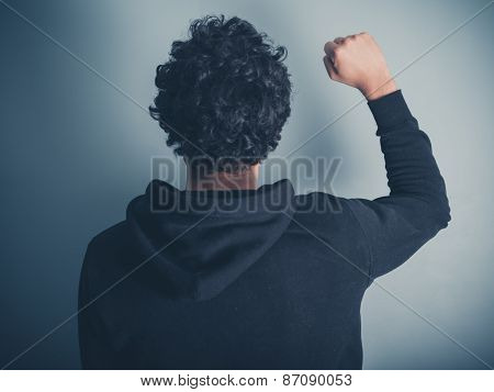 Man In Hooded Top Raising His Fist