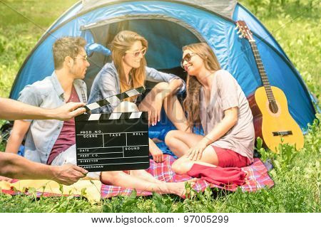 Group Of Friends Camping In The Park - Ciak Clapperboard With Young Actors In The Nature