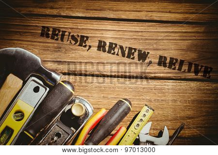 The word reuse, renew, relive against tools on desk