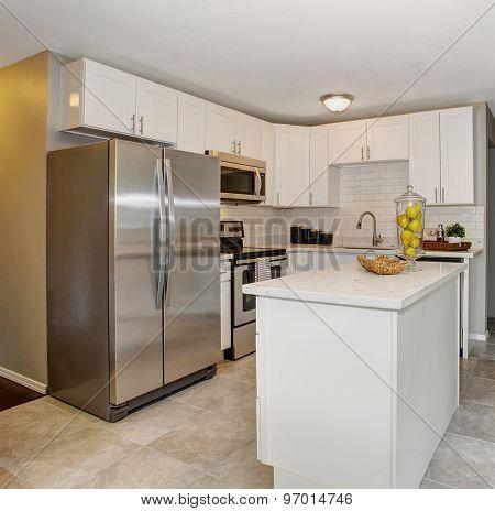 Modernized Kitchen With Grey And White Theme.