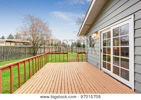 Lovely Back Yard With Deck And Grass.
