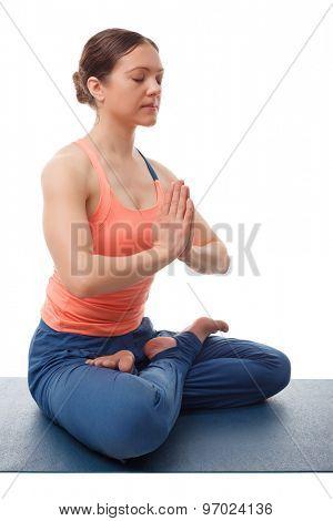 Beautiful sporty fit yogini woman meditates in yoga asana Padmasana - lotus pose with namaste poster