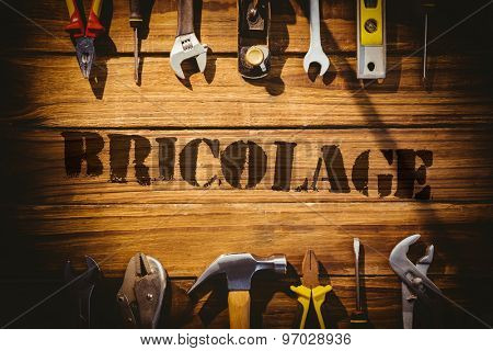 The word bricolage against desk with tools