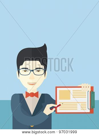 A handsome hipster Caucasian man wearing blue jacket holding his clipboard with paper where he wrote his report happily presenting his marketing plan. Marketing strategy concept. A contemporary style