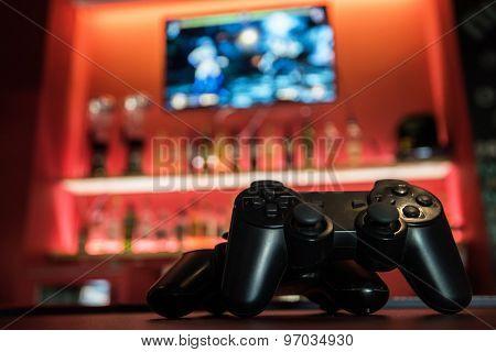 Video games at bar counter poster