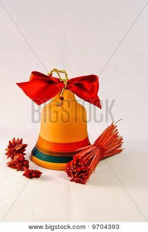 Orange Bell With Red Ribbon On Top