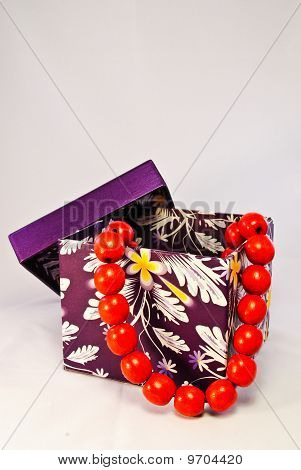 Purple Gift Box With Red Beads